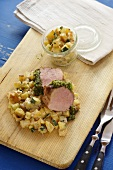 Pork fillet with a herb crust and a courgette medley