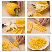 Gelbe Paprikaschote entkernen und in Würfel schneiden