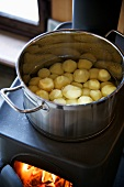 Peeled potatoes in a pot of water