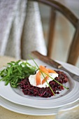 Beetroot cake with sour cream and smoked salmon