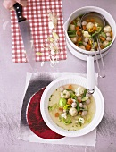 Clear broth with vegetables and dumplings