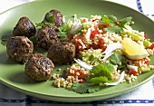 Meat balls with bread salad and coriander