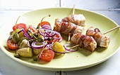 Chicken roulade with bacon and potato and tomato salad