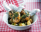 Grilled chicken drumsticks with herbs and potatoes