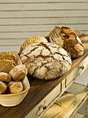 Various types of organic bread on a wooden surface