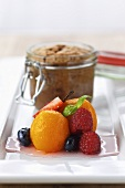 Chocolate souffle in a jar with marinated fruit