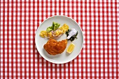 Roasted chicken leg with potato salad (Austria)