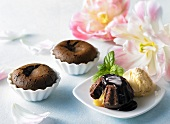 Chocolate cakes with egg liqueur, chocolate sauce and ice cream