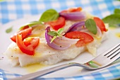 Trout fillets with tomatoes and red onions (close-up)