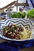 Lamb ragout with almonds and couscous