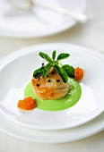 A scallop with avocado cream and caviar