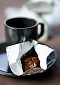 Italian chocolate truffle and a cup of coffee