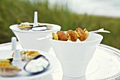 Curry cream soup with a baked mussel kebab