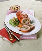 Cochon de lait roulade with mushy peas