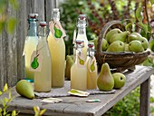 Fresh pears and pear juice in bottles