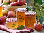 Apple jelly in painted jars, fresh apples