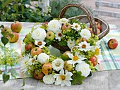Late summer wreath of dahlias, apples, zinnias, fennel