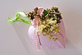 Metal heart with oregano flowers and meadowsweet