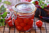 Bottled cherry tomatoes in preserving jar