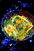 Cheese and orange salad with rocket and chilli