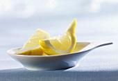 Small dish of lemon wedges