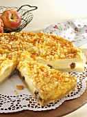 Cheesecake with apples and raisins, a piece cut