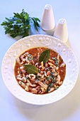 Tripe soup with tomatoes, bay leaves and parsley