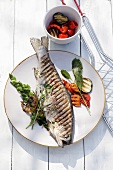Grilled trout with herbs and vegetables