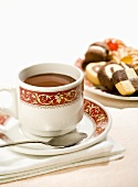 Hot chocolate and plate of biscuits