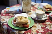 Panini and cappuccino on restaurant table (Italy)