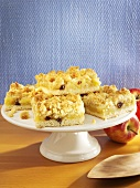 Several pieces of apple cake with advocaat crumble