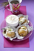 Baked potatoes with garlic dip