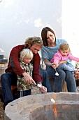 Family toasting marshmallows