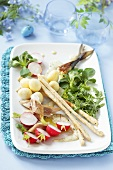 Quails' eggs with smoked fish, salad and grissini