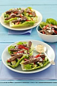Beef, cucumber and coriander in romaine lettuce boats