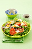 Salad of egg, green beans, lettuce, onion and tomato