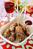 Cevapcici with sesame seeds on cocktail sticks