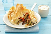 Pork with vegetables and sheep's cheese in filo pastry