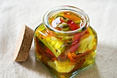 Achards (French spicy vegetable pickle) in jar