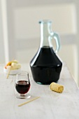 Cassis liqueur in glass and carafe