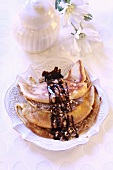 Pancakes with nut filling and chocolate sauce