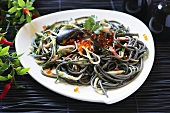 Squid ink pasta with seafood and caviar