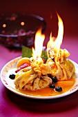 Flambéed pancake purses