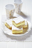 Cream slices with icing sugar