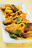 Fish in curry marinade (India and South Africa)