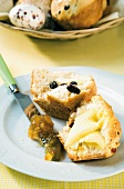Hot cross muffin buns with butter and marmalade