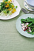 Spinach & radish salad and cabbage, orange & celery salad with chilli