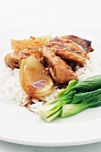 Lemon and honey chicken with onions, pak choi and rice