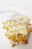 Star-shaped biscuits with icing and silver dragees