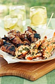 Barbecued sausages and prawns